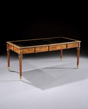 A GEORGE III ORMOLU MOUNTED SATINWOOD, TULIPWOOD AND COCOBOLO WRITING TABLE ATTRIBUTED TO CHRISTOPHER FUHRLOHG