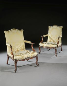 A PAIR OF GEORGE III MAHOGANY LIBRARY ARMCHAIRS ALMOST CERTAINLY BY THOMAS CHIPPENDALE