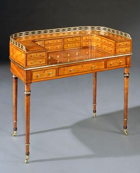 A GEORGE III SATINWOOD CARLTON HOUSE WRITING TABLE