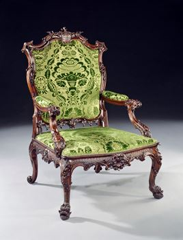A GEORGE II CARVED MAHOGANY OPEN ARM CHAIR BEARING THE BARRINGTON ARMS, ATTRIBUTED TO JOHN LINNELL