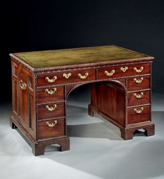 A GEORGE II CARVED MAHOGANY PEDESTAL PARTNERS DESK ATTRIBUTED TO WILLIAM HALLETT