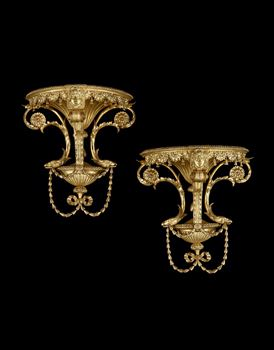 A PAIR OF GEORGE III GILTWOOD WALL BRACKETS
