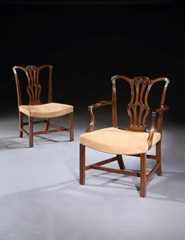 A SET OF TEN GEORGE III MAHOGANY DINING CHAIRS AND FOUR SIDE CHAIRS OF LATER DATE