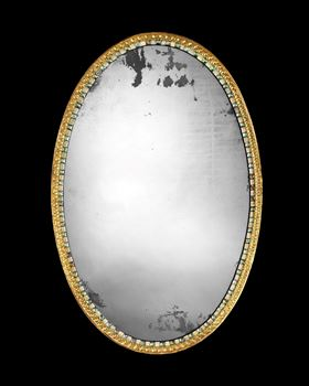 AN IRISH GEORGE III GILTWOOD AND CUT GLASS OVAL MIRROR