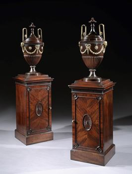 A PAIR OF GEORGE III DINING ROOM URNS ON PEDESTALS PROBABLY BY THOMAS CHIPPENDALE