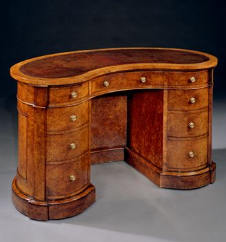 A VICTORIAN BURR WALNUT KIDNEY DESK BY HOLLAND & SONS