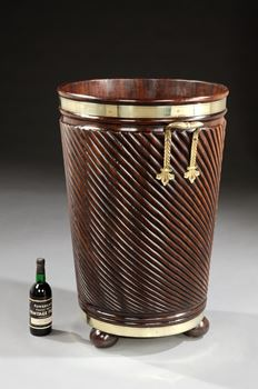 AN IRISH REGENCY BRASS-BOUND MAHOGANY LOG BUCKET