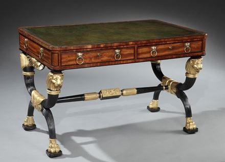 A REGENCY MAHOGANY EBONISED AND PARCEL GILT WRITING TABLE