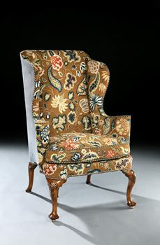 A QUEEN ANNE WALNUT WING CHAIR