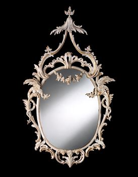 AN EXCEPTIONAL OVAL LOOKING GLASS