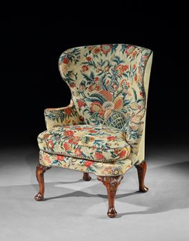 A GEORGE I WALNUT WING CHAIR