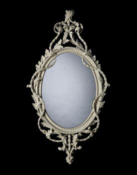 A GEORGE III GILTWOOD OVAL MIRROR ATTRIBUTED TO JOHN LINNELL