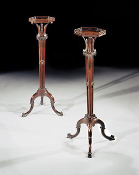 A PAIR OF GEORGE III MAHOGANY TORCHERES ATTRIBUTED TO THOMAS CHIPPENDALE