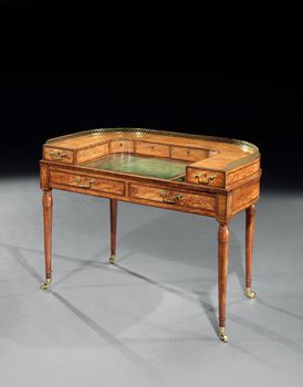 A GEORGE III SATINWOOD CARLTON HOUSE WRITING TABLE ATTRIBUTED TO GILLOWS