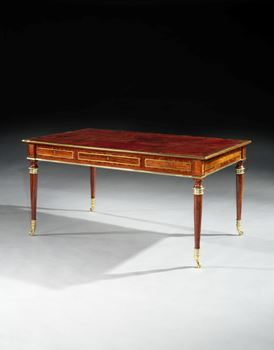 A REGENCY BRASS MOUNTED COCOBOLO AND GONCALO ALVES WRITING TABLE