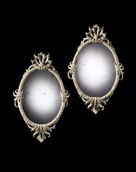 A PAIR OF GEORGE II PAINTED OVAL MIRRORS