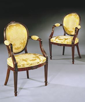 A PAIR OF GEORGE III MAHOGANY ARMCHAIRS ATTRIBUTED TO GILLOWS OF LANCASTER
