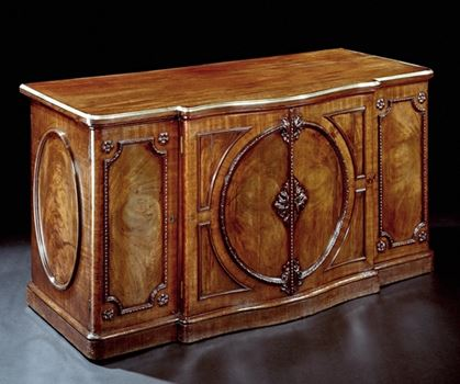 A HIGHLY IMPORTANT SERPENTINE COMMODE ATTRIBUTED TO JOHN BRADBURN