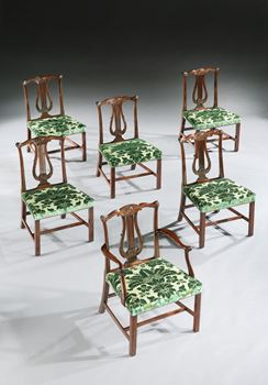 A SET OF TWELVE GEORGE III DINING CHAIRS ATTRIBUTED TO THOMAS CHIPPENDALE