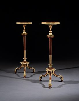 A PAIR OF GEORGE III ROSEWOOD TORCHÈRES ATTRIBUTED TO THOMAS CHIPPENDALE