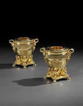 A PAIR OF GEORGE III GILT BRONZE WINE COOLERS BY RUNDELL, BRIDGE & RUNDELL TO A DESIGN BY JEAN-JACQUES BOILEAU