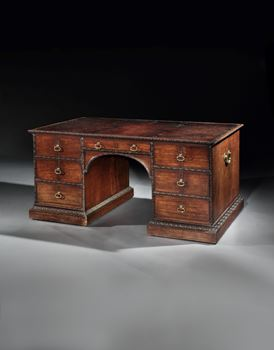 A GEORGE II MAHOGANY LIBRARY TABLE ATTRIBUTED TO WILLIAM HALLETT
