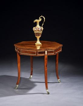 A GEORGE III BRASS MOUNTED AND PARCEL GILT ROSEWOOD CENTRE TABLE