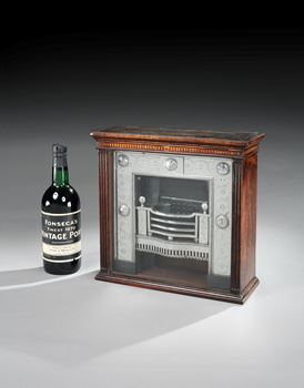 A VICTORIAN COBALT AND IRON SALESMAN'S MODEL OF A CHAPTER FIREPLACE