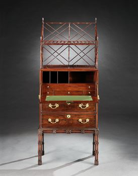 A GEORGE III MAHOGANY SECRÉTAIRE CABINET ON STAND ATTRIBUTED TO WILLIAM VILE