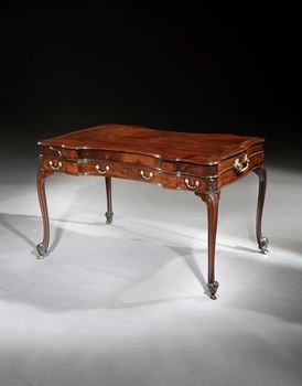 A GEORGE III MAHOGANY WRITING TABLE ALMOST CERTAINLY BY WILLIAM VILE