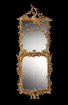 A GEORGE III GILTWOOD MIRROR ATTRIBUTED TO MAYHEW AND INCE