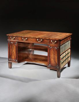 A GEORGE III PEDESTAL WRITING DESK