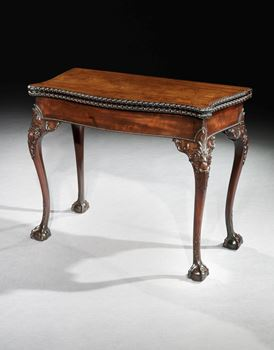 A GEORGE II MAHOGANY CARD TABLE WITH NEEDLEWORK PLAYING SURFACE