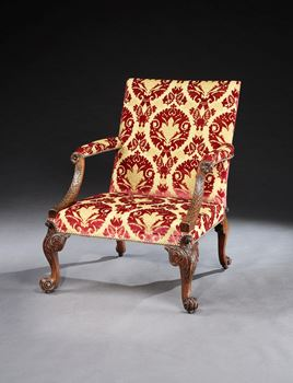 A GEORGE II WALNUT LIBRARY ARMCHAIR ATTRIBUTED TO GILES GRENDEY