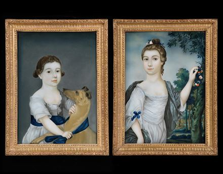 A PAIR OF GEORGE III CHINESE EXPORT REVERSE GLASS PAINTED PORTRAITS