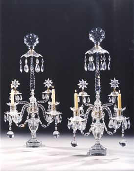 A PAIR OF GEORGE III CUT GLASS TWO LIGHT CANDELABRA ATTRIBUTED TO WILLIAM PARKER