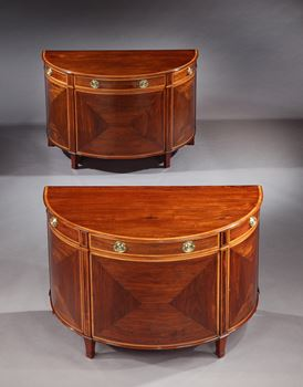 A PAIR OF GEORGE III DEMI-LUNE GONÇALO ALVES COMMODES