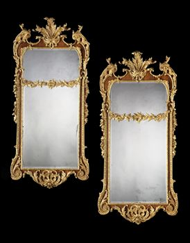 A PAIR OF GEORGE II PARCEL GILT WALNUT PIER MIRRORS