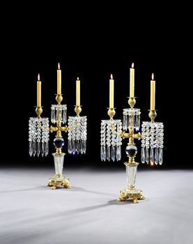 A PAIR OF REGENCY ORMOLU MOUNTED CUT GLASS CANDELABRA BY JOHN BLADES