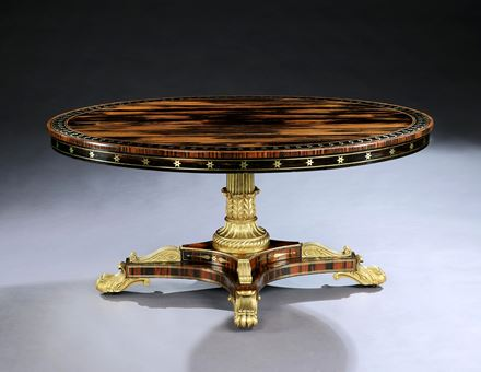 A REGENCY PARCEL GILT COROMANDEL AND EBONY OVAL BREAKFAST TABLE ATTRIBUTED TO GEORGE OAKLEY