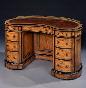 A VICTORIAN ORMOLU MOUNTED SATINWOOD KIDNEY DESK