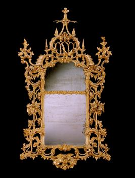 A MAGNIFICENT IRISH GEORGE III GILTWOOD MIRROR