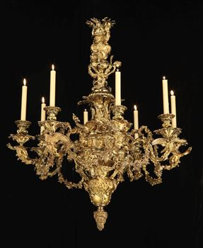 A GEORGE IV EIGHT LIGHT BRASS CHANDELIER BY JOHNSTON BROOKES & CO