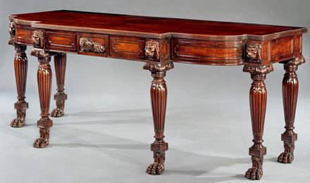 A REGENCY CARVED MAHOGANY SIDE TABLE