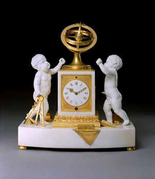 A REGENCY WHITE MARBLE PORCELAIN AND ORMOLU CLOCK BY VULLIAMY