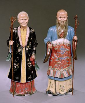 A PAIR OF QIANLONG PERIOD CHINESE EXPORT POLYCHROME DECORATED CLAY NODDING FIGURES