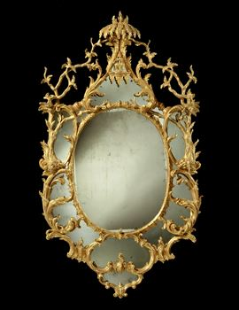 A MAGNIFICENT GEORGE III MIRROR IN THE MANNER OF JOHN LINNELL