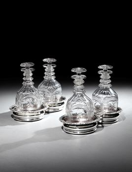 A PAIR OF REGENCY SILVER PLATE DOUBLE DECANTER COASTERS BY MATTHEW BOULTON