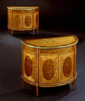 A PAIR OF GEORGE III SATINWOOD COMMODES