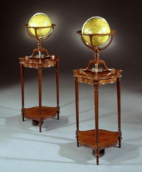 A RARE PAIR OF GEORGE III TABLE GLOBES BY DUDLEY ADAMS ON MAHOGANY STANDS